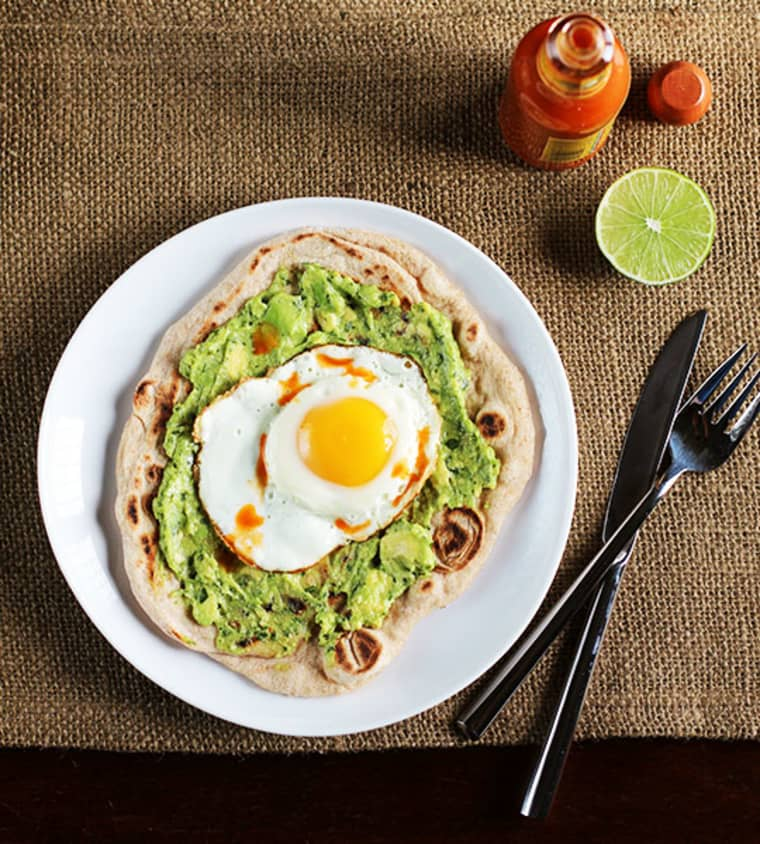 Sunny side up egg with avocado spread on a whole wheat tortilla